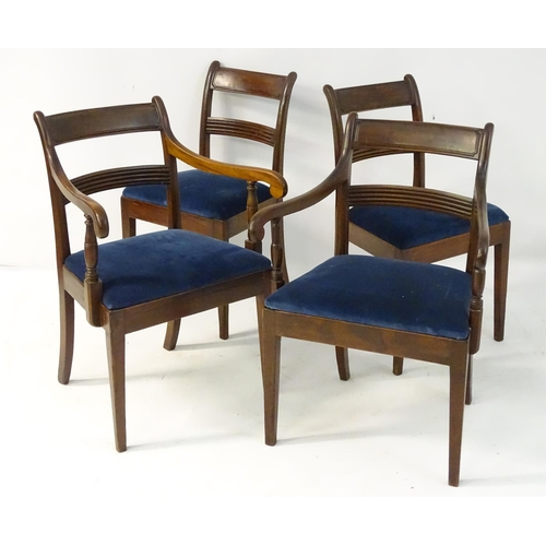 15 - A set of four 19thC mahogany dining chairs with curved top rail, chamfered mid rail and scrolled arm...