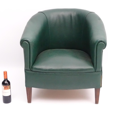 57 - A mid 20thC green tub chair standing on squared tapering legs. 28'' wide x 25'' deep....