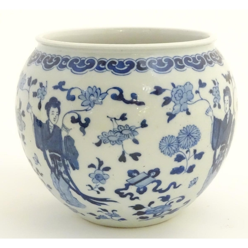17 - A blue and white Oriental jardiniere, decorated with figures in traditional dress and flowers. Marke...