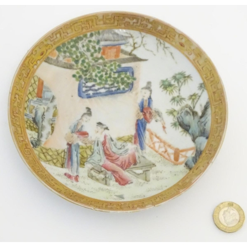 5 - A small Chinese famille rose plate decorated with figures on a terrace within a landscape with a pag...