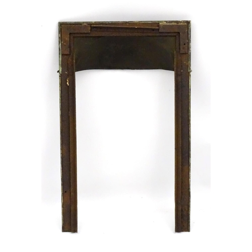 51 - An Arts and Crafts hammered copper hooded fire surround with beaded decoration. 18 ½'' wide x 30 ½''...