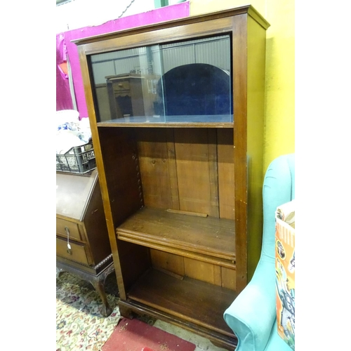 52 - A large stained pine 4 tier bookcase, with glazed and blue baize lined top section...