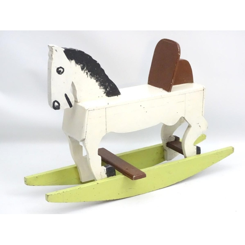 57 - Rocking horse : a scratch built and painted wooden rocking horse on bows with brown painted back and...