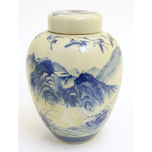 1 - A large blue and white Japanese lidded ginger jar decorated with a sage sat by a tree in a landscape...