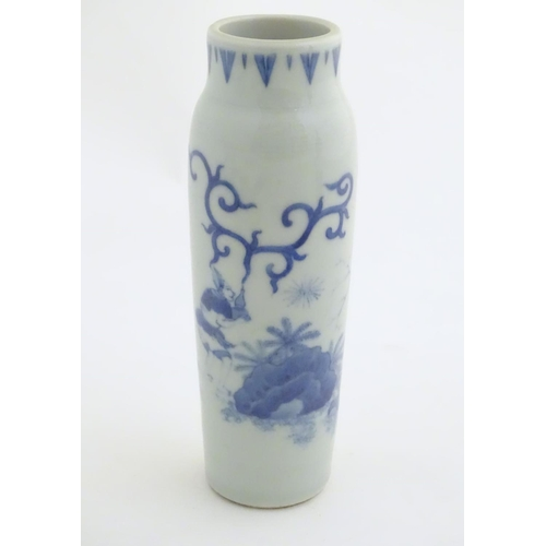 2 - A Chinese blue and white vase of narrow form, depicting figures in a stylised landscape. Approx. 8 1...