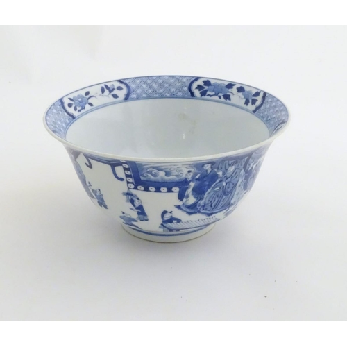 9 - A Chinese blue and white footed bowl with a flared rim, decorated with a scene depicting the enterta...