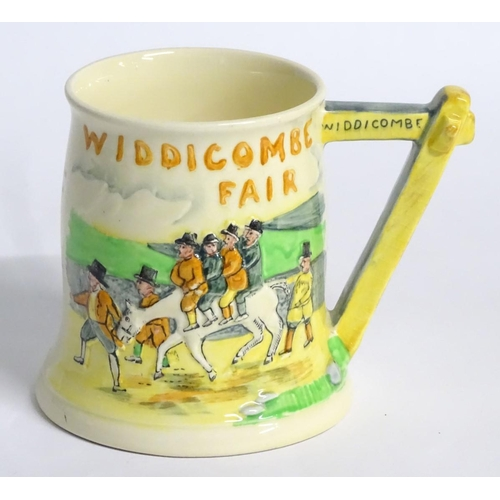 35 - Hunting: A 20thC Crown Devon Fieldings Widdicombe Fair musical tankard, decorated with figures on ho...