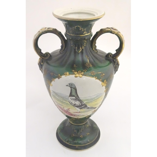 40 - A 20thC baluster vase with a bulbous body, flared foot and rim and twin loop handles. Decorated with...