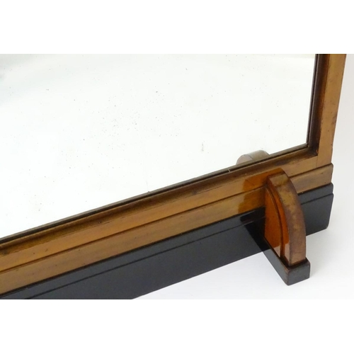 1079 - A large mid 20thC Art Deco mirror with a walnut and ebonised frame. 60'' wide x 73'' high...
