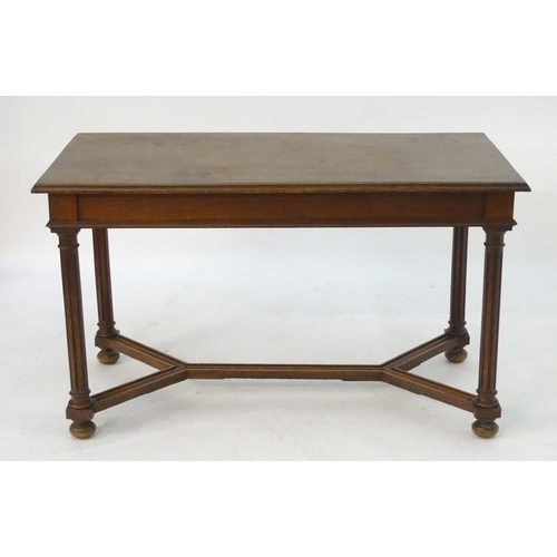 1070A - A late 19thC table with an oak top above a walnut base, having a single short drawer to one end and ...