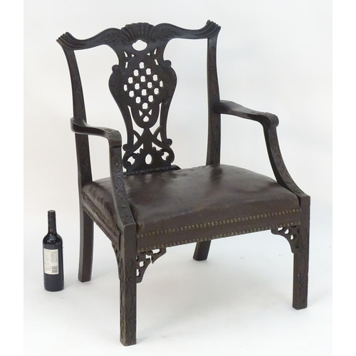 1073 - An Irish 19thC mahogany Chinese Chippendale open armchair with carved frame and pierced back splat, ...