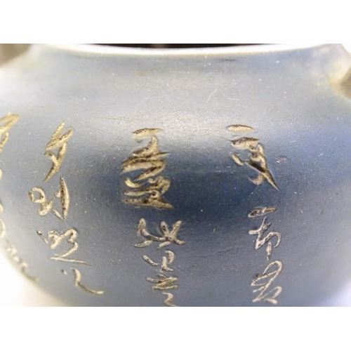 10A - A small Chinese Yixing earthenware / clay teapot and cover with a blue ground, the handle modelled a...