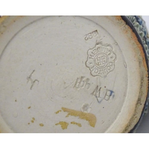 30 - A 19thC Doulton Lambeth jug with a banded floral design in relief by Clara Baker. Doulton Lambeth st...