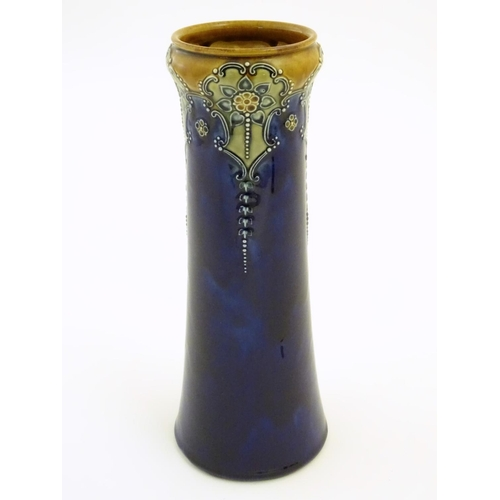 33 - A Royal Doulton vase with stylised Art Nouveau flowers in relief. Royal Doulton stamp and maker's ma...