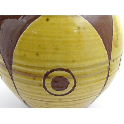 46 - A large earthenware studio pottery baluster vase / jug with single handle, with a brown ground decor...