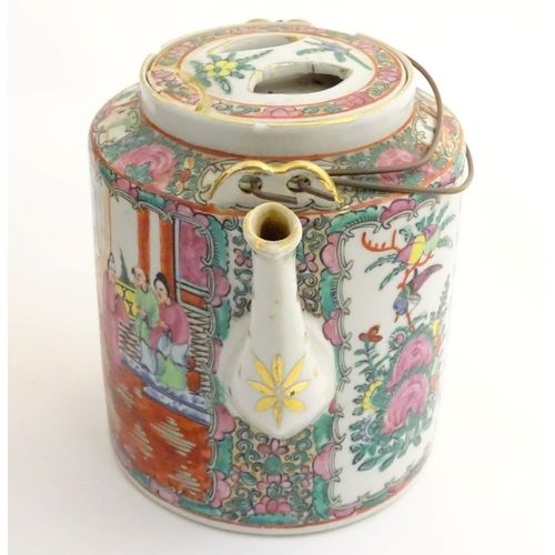 16A - A Chinese Cantonese teapot and cover with famille rose decoration with panelled decoration depicting...