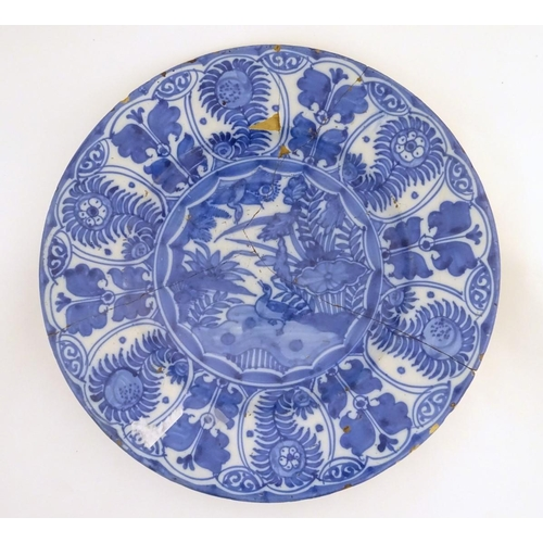 22A - A blue and white Chinese Export Kraak style charger, with panelled decoration depicting stylised flo...