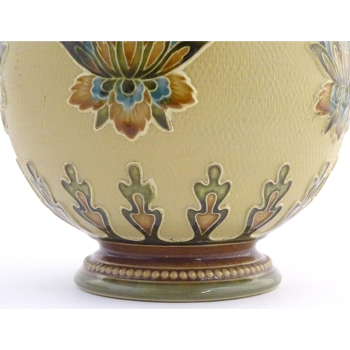 32 - A Mettlach vase with a flared rim and bulbous body, decorated with sylised floral and foliate motifs...