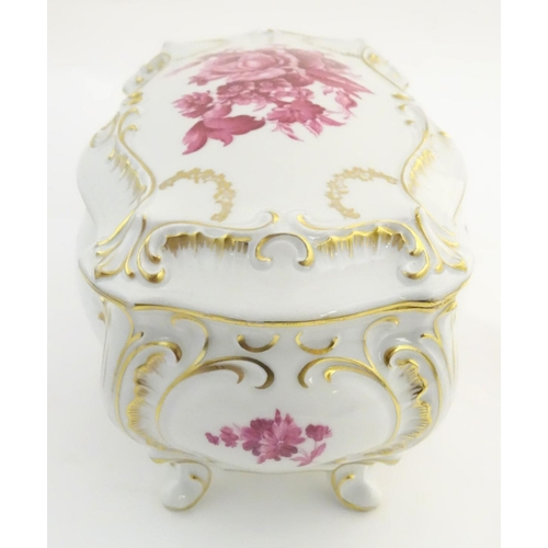 41 - A German Graf von Henneberg porcelain casket and cover decorated with pink flowers and foliage and g...