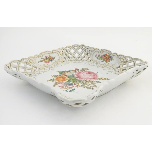42 - A Continental dish of square form with handpainted floral decoration and a reticulated border with g...