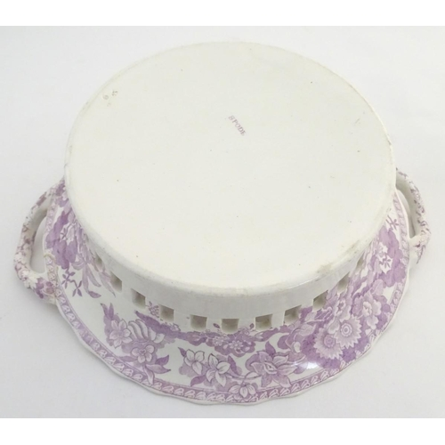 43 - A Spode twin handled chestnut basket and stand with lobed rims and a reticulated band. Decorated wit...