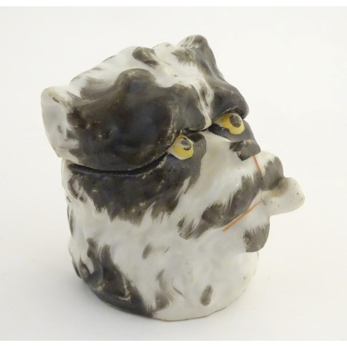 55 - A 19thC handpainted Continental table top snuff box formed as a dog smoking a pipe. Approx. 2 1/4