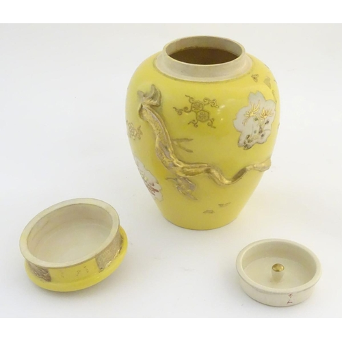 6 - A Chinese yellow ground ginger jar with lid and lid liner. The body with gilt decoration in relief d...