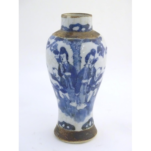5 - A Chinese blue and white baluster vase depicting figures in a landscape, with incised banded border ...