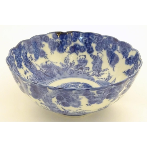12 - An Oriental bowl with a lobed rim, decorated with figures in a landscape. Approx. 5'' high x 7'' dia...