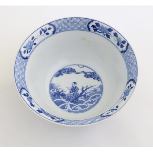 13 - A Chinese blue and white footed bowl with a flared rim, decorated with a scene depicting the enterta...