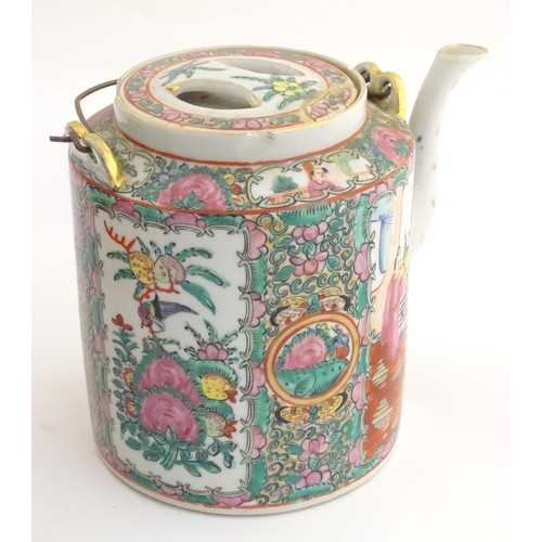 17 - A Chinese Cantonese teapot and cover with famille rose decoration with panelled decoration depicting...