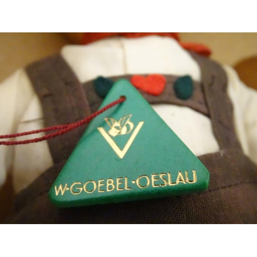 47 - A large M.J. Hummel Goebel vinyl figure of a young boy in Bavarian alpine dress with a painted face ...