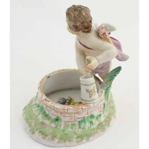 48 - A 19thC Berlin salt modelled as a cherub holding a tankard above a brick well, the interior painted ...