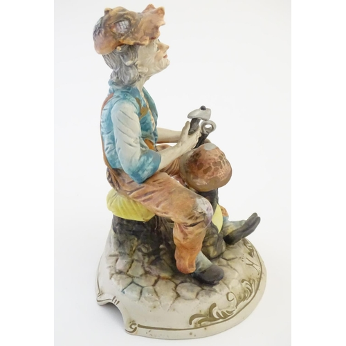 50 - A Capodimonte figure of an elderly man with tools, possibly an armourer. Indistinctly signed to base...