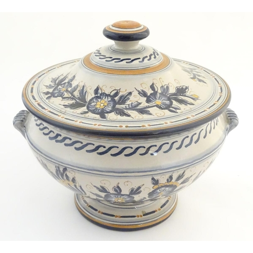 60 - An Italian stoneware footed tureen of urn form with banded floral decoration. Signed under Marcucci ...