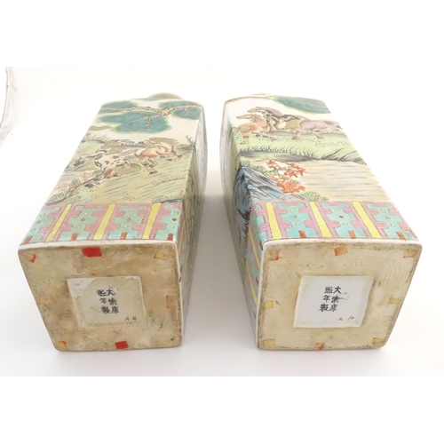 1 - A pair of Chinese square sectional vases with flared rims, decorated with horses in a landscape scen...