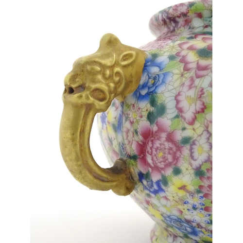 3 - A Chinese famille rose millefiore twin handled pot and cover decorated with a profusion of flowers a...