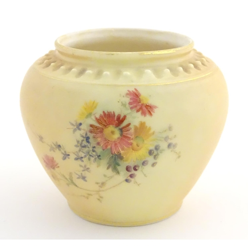 32 - A Royal Worcester blush ivory vase with floral decoration and gilt highlights. Marked under. Approx....