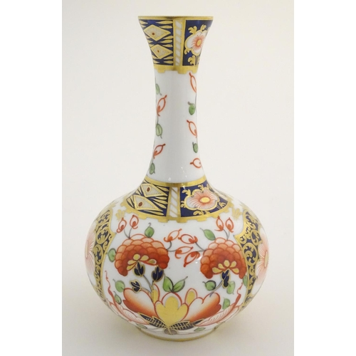 37 - A 19thC Stevenson and Hancock Derby vase decorated with flowers in the Imari palette. Marked under. ...