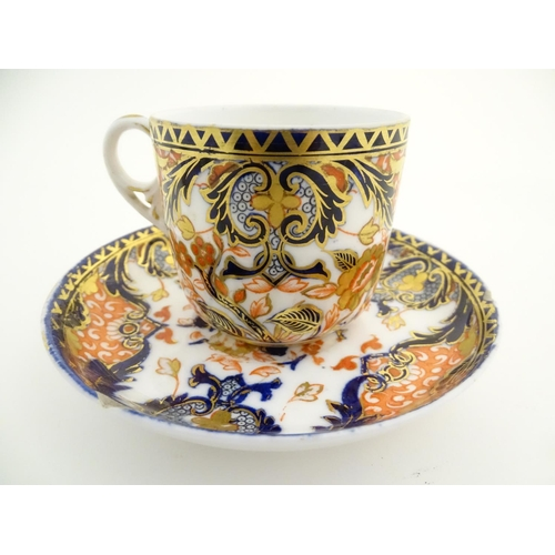 40 - A Royal Crown Derby tea cup and saucer in the Imari palette with floral and scrolling foliate decora...