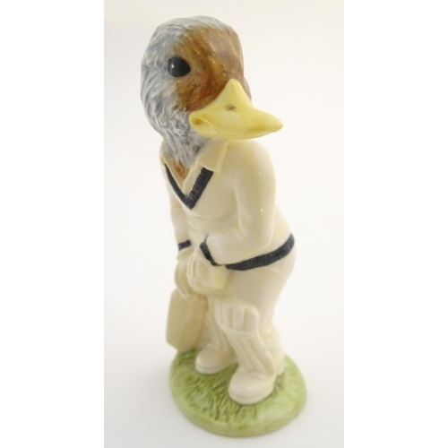 41 - A Beswick Sporting Characters animal figure ' Out for a Duck ', modelled as a duck in cricket whites...
