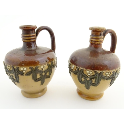 44 - A pair of Royal Doulton miniature salt glaze vases of flagon form with foliate decoration. Impressed...