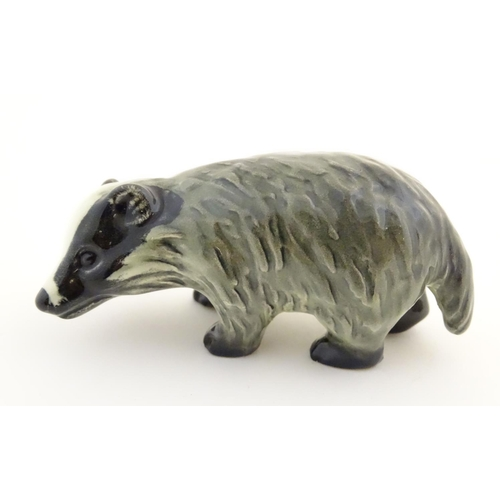 51 - A Goebel model of a badger. Marked under, impressed 48 to foot. Approx. 1 3/4