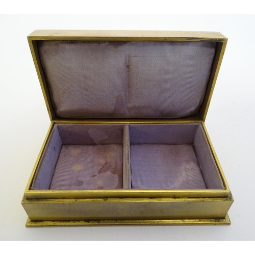 733 - An unusual Victorian gilt metal box set with twin oval locket sections to lid containing locks of ha...