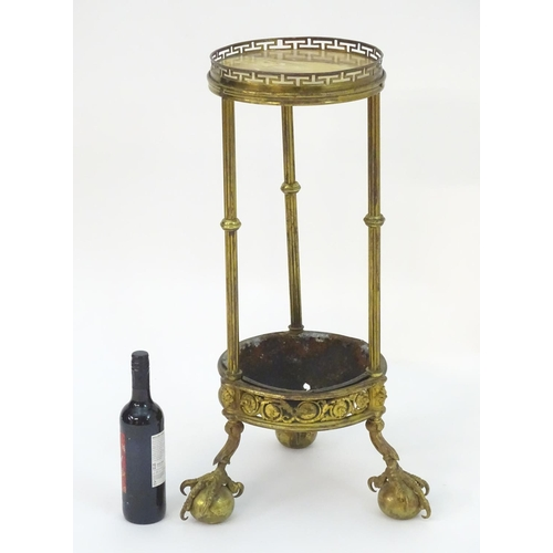 1014 - A 19thC gilt bronze lamp table with a marble top and pierced gilt surround above three fluted suppor...