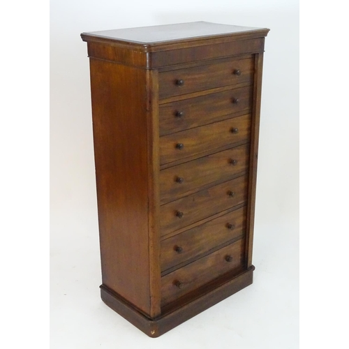 1016 - A 19thC mahogany Gillows Style Wellington chest with a moulded rectangular top above seven graduated...