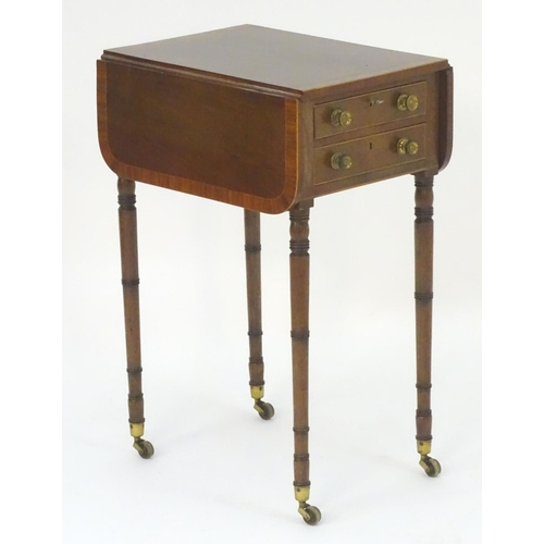 1026 - A late 18thC / early 19thC mahogany pembroke style work table with crossbanded top and drop flaps, t...