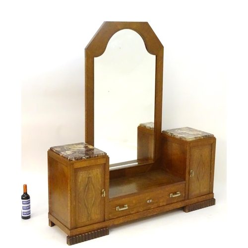 1050A - An early / mid 20thC Art Deco dressing table, having two marble topped cabinets above panelled cupbo...