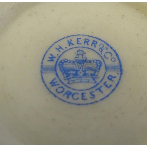 43 - A W H Kerr & Co. of Worcester vase with a flared rim, twin moulded mask handles and handpainted deco...