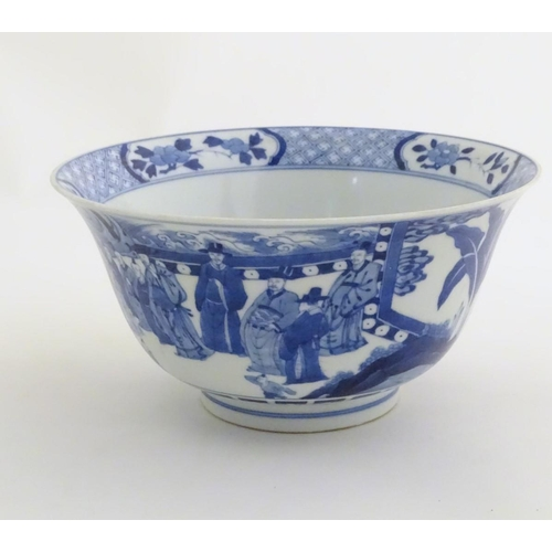 1 - A Chinese blue and white footed bowl with a flared rim, decorated with a scene depicting the enterta...